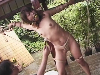 Asian female trussed and limited with..